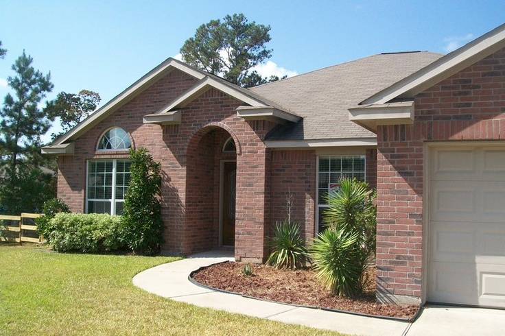 1 story home located on 1.2 acres (plenty of room for BOAT and/or RV Parking) Great neighborhood with lots of trees! Nice entry w/arched doorways to FORMAL LIVING & FORMAL DINING! Master Suite with separate shower and whirlpool tub! Split plan. Beautiful concrete flooring! Family room opens to kitchen, high ceiling and wall of windows overlooking deck and park like back yard! Fabulous island kitchen w/breakfast bar! Excellent Magnolia School District!
