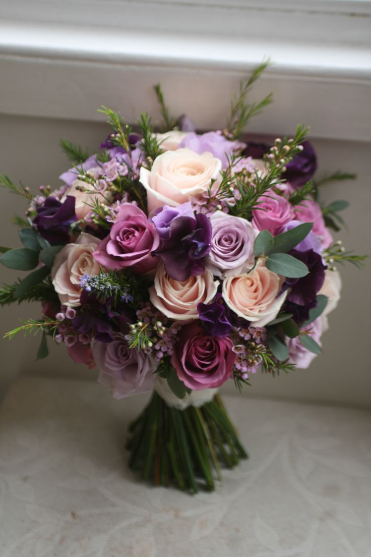Wedding bouquet of sweet avalanche, ocean song and cool water roses, waxflower eustoma and sweet peas.  Liberty blooms