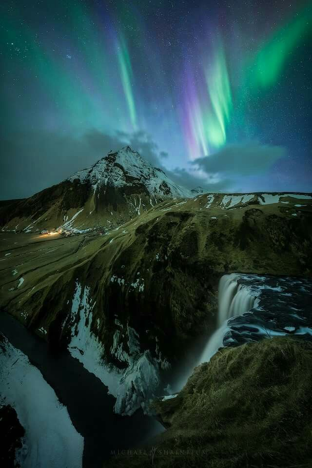 The Northern Lights over Skógafoss in Iceland. Michael Shainblum photography