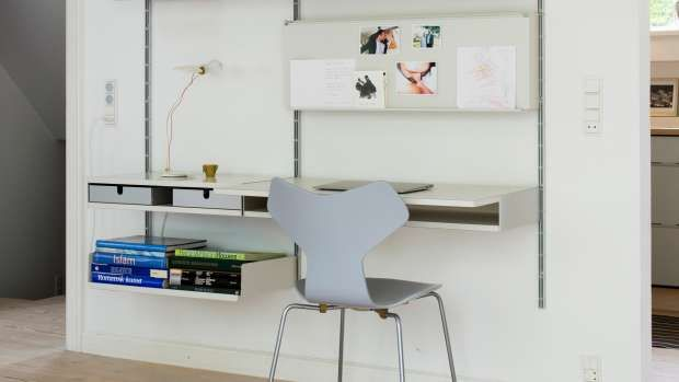 The deeper desk shelf on the right is ideal to work on. The pinboard above the desk is a metal shelf rotated; notes are attached using magnets