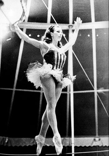 Claire-Motte walking a tightrope en pointe, 1976 ~