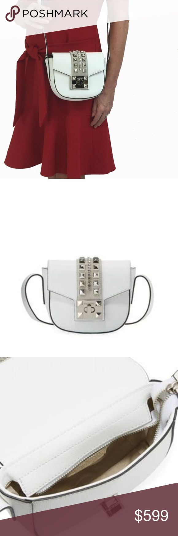 """FinalSALE Valentino Leather Rockstud Crossbody Bag Valentino By Mario Valentino SAFFIANO leather studs crossbody bag  SALE PRICE IS FIRM!  SOfT, LUXURIOUS LEATHER, RHINESTONE AND STUD HANDBAG  Neutral thread and black edges on white leather Spike studs and rhinestone embellished trim on light grey suede Adjustable shoulder strap, 22.8"""" drop Flap top covers recessed zip top closure Turn-lock closure Interior, fabric lining Made in Italy  Dust bag, Valentino tag, Certificato Di Qualita Booklet…"""