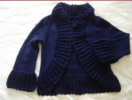 Knitting patterns for a ladies plus sizes, 8ply jacket with 3/4 sleeves and lace edges.