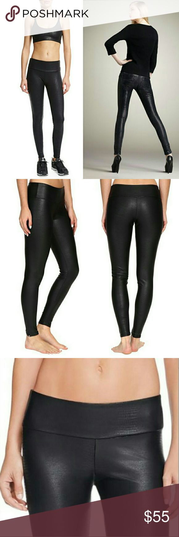"""NWT Onzie high-rise snake embossed legging Great for work or play, these makes-your-butt-look-amazing leggings have a subtly embossed snake print. The legging itself is matte black spandex but the embossing is shiny. 28""""inseam, 9"""" rise, 31"""" waist with a lot of give. This is a size M/L.  Also, I bought these directly from the manufacturer, so they do not have a price tag, but they are in the factory packaging. Onzie Pants Leggings"""