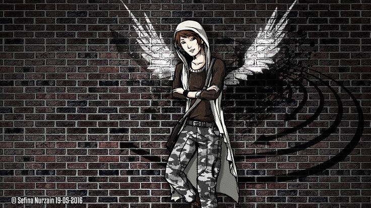 Elanto at front of brick mural wall #urbanherocorps #urban #hero #corps #elanto #darrel #elantodarrel #wings #angel #wing #angelwings #mural #brick #urbancorps