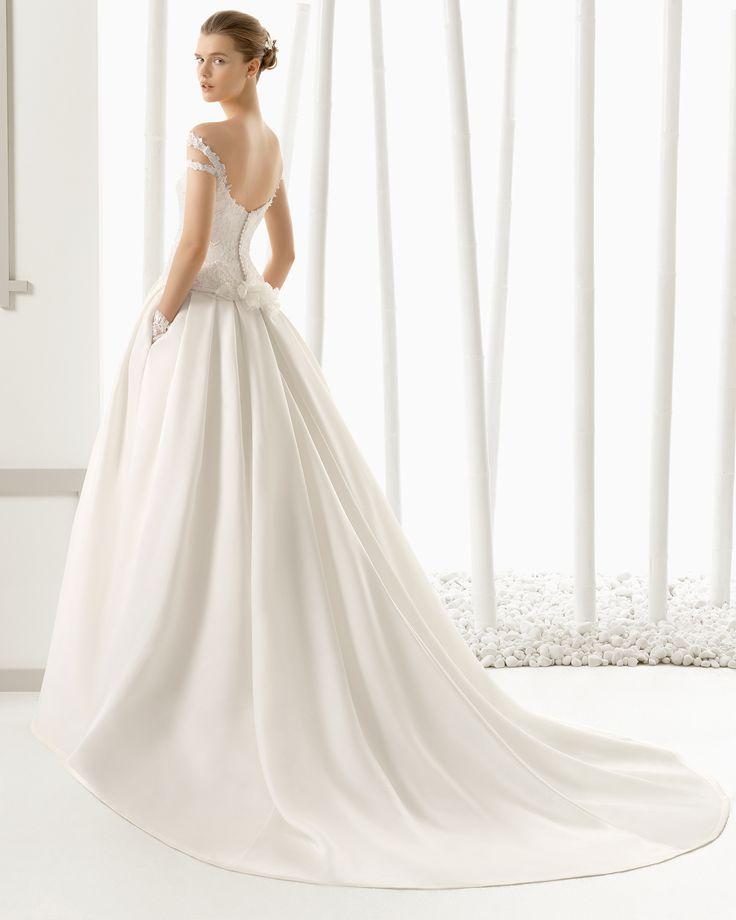 DIANA traje de novia en encaje pedrería y organza de seda.