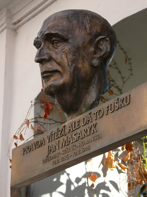 "Monument to Jan Masaryk, with the inscription ""Truth will prevail, but it's going to take some work""."