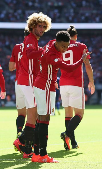 Jesse Lingard of Manchester United celebrates scoring their first goal during the FA Community Shield match between Leicester City and Manchester...
