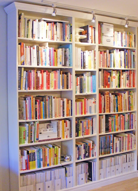 IKEA bookcases with crown molding- looks just like built-ins. LOVE this blog!!