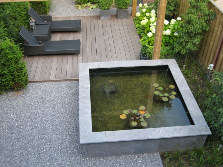 small deck sun lounge area with raised contemporary pond - rolandvanboxmeer mooie combi van materiaal