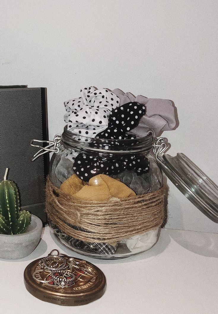 Cactus candle from Kmart, rings on old mason jar lid
