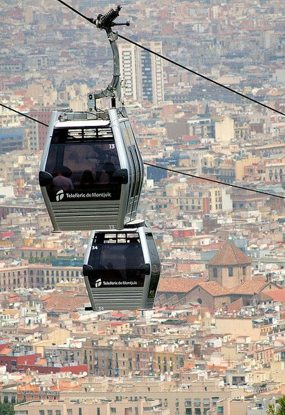 Barcelona's Montjuic Cable Cars carry you up the mountain, providing unparalleled views of the city during the journey and when you reach your destination. A magnificent vantage point.
