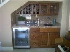 wet bar under stairs   Wine Bar - great use of space under the stairs