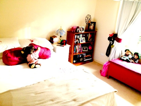 Chelsea's Country Style bedroom.  Love the pink, and the fact that her teddy's still take prime position on her bed.