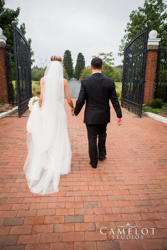 Bride and Groom walking at Bourne Mansion