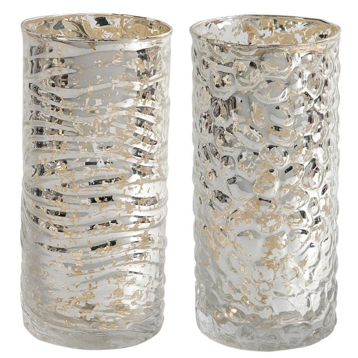 A&B Home Mercury Glass Votive Holders - 2Pc/Box - Set of 2. Our transitional-style Evora Mercury Glass Candle Holders are gleaming beacons of light when they adorn a festively decorated dining table or fireplace mantle. Double the sparkle in your space - this tabletop decor is available as a pair.