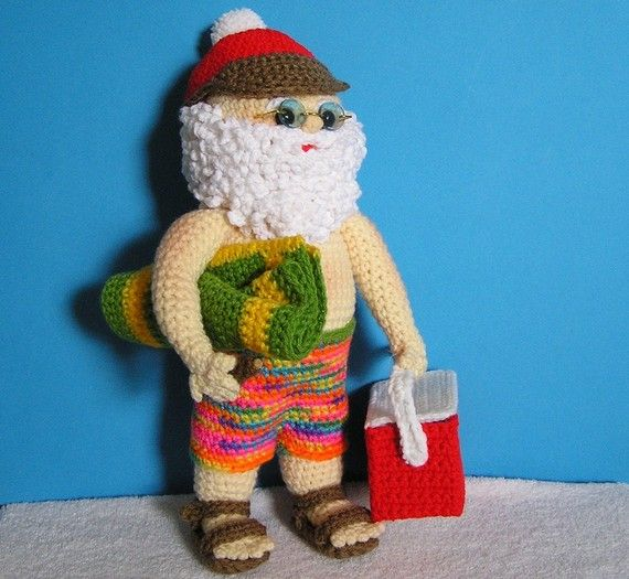 **Note that this is a pattern only. It is not the finished Santa**    Even Santa needs a nice summer vacation once in a while. Here he is in his swim
