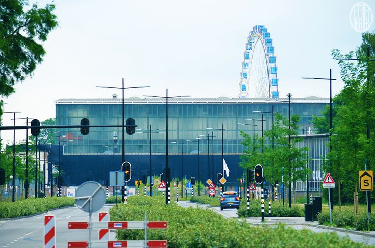 The new train station and in the background the ferris wheel - Tilburg