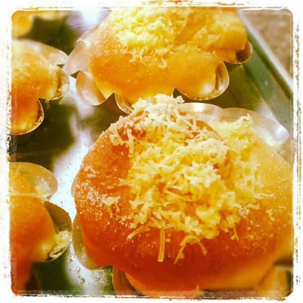 Philippine Ensaimada, sweet dough layered with butter, cheese and sugar, rolled into a snail-like shape. Similar to the French Brioche, only more sinful!