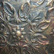 It's easy to order any tin ceiling tiles that you like and paint and distress them to look like they are really old. There are several sites on the internet with 100's of tile designs to choose from.