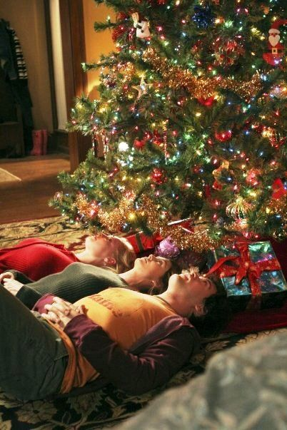 Lying beneath the branches of my Christmas tree and making faces in the bulbs…