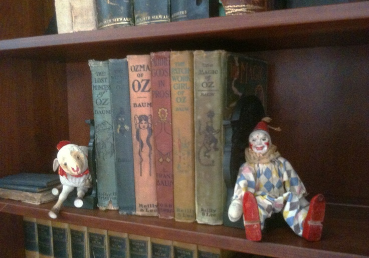 Lucky enough to have my father's childhood books & toys, I love to display them on my bookshelves. Here is my iPhone pic of his original Oz books & Schoenhut Humpty Dumpty Circus toys.