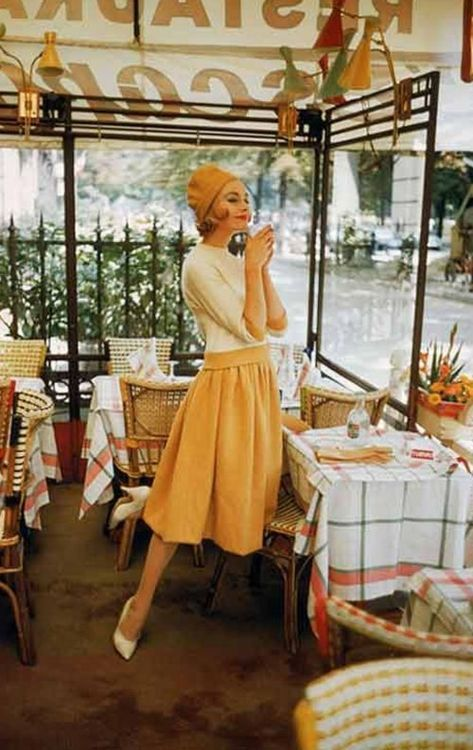 1957 in a paris cafe late 50s day wear casual dress skirt tan cream sherbet orange white coral wool fall winter to early 60s color photo print ad model vintage fashion style