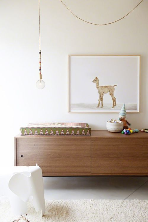 This mid -century modern floating credenza adds a sophisticated touch to a simple, yet playful room. https://emfurn.com
