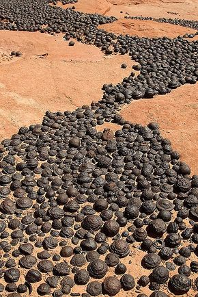 great pics: Moqui Marbles, naturally occurring iron oxide concretions that arise from navajo sandstone. Very prevalent in the Escalante Grand Staircase National Monument.