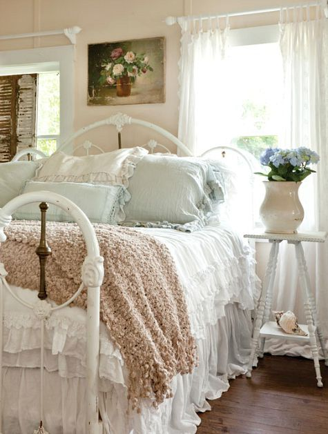 Country Cottage Style Bedroom With Iron Bed And White Blue Bedding