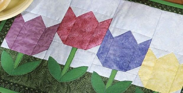 There Are So Many Ways to Use These Tulip Blocks! The blooms in this little tulips quilt are made from simple piecing. Easy fusible applique is used for the leaves. Together, they combine into a sweet little quilt to use as place mats, a table topper or to hang on your wall. You can configure …
