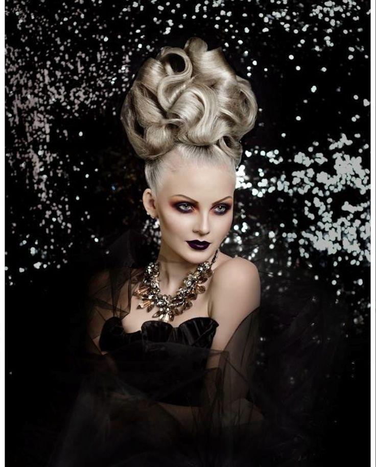 Gorgeous sculpted #updo by Ruslan Tatyanin of Russia. #HotOnBeauty www.hotonbeauty.com #PlatinumBlonde