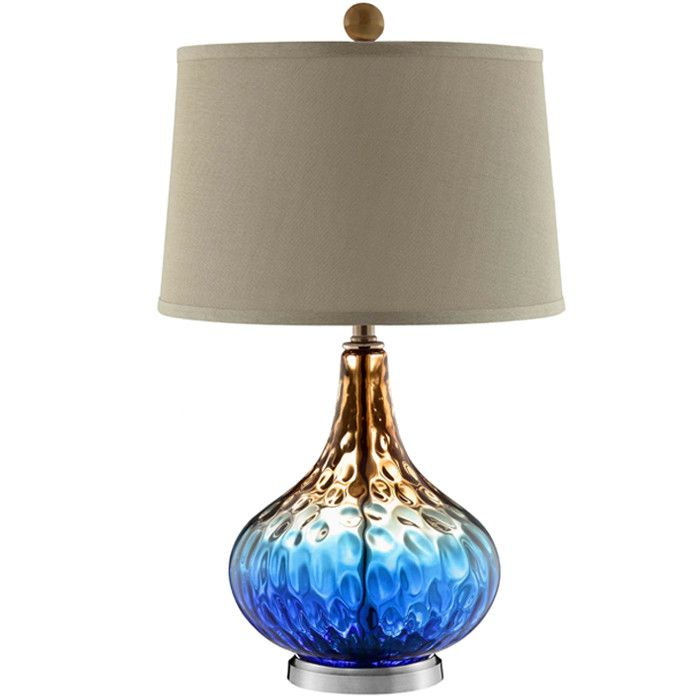 Rich hues ranging from warm gold to cobalt blue adorn this multicolored shelley table lamp with unprecedented beauty
