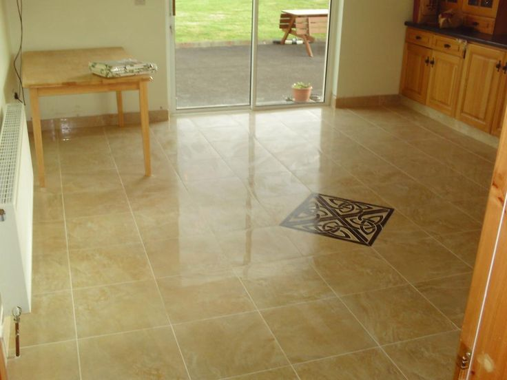 Marble Effect Tile Kitchen Floor With Celtic Design Centrepiece