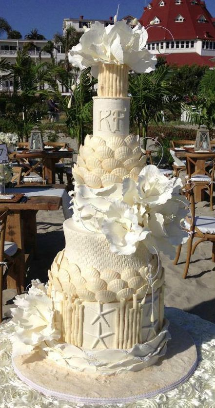 These drop-dead gorgeous wedding cakes from Lindsey Sinatra of A Wish And A Whisk Cakes are sure to wow your wedding guests at the reception. I'm in love with the exquisite sugar flower and ruffle details of these cakes. Take a look!