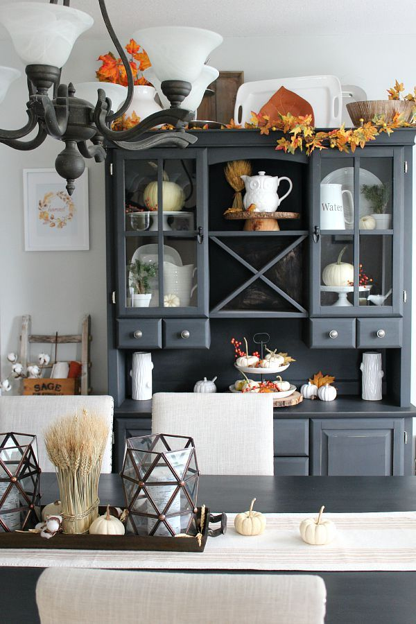 Pops of color from acorns, leaves, and artificial cranberries offset this neutral fall decor.  Learn more at Clean and Scentsible.   - CountryLiving.com