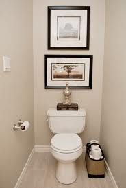 Simple decor in a small space - large square frame flanked by a large  rectangular frame  Small Toilet RoomSmall ...