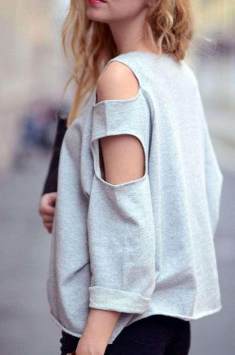 cut out an oval on each shoulder on either side of the sweatshirt, and one four inches below. perfect summer throwback top