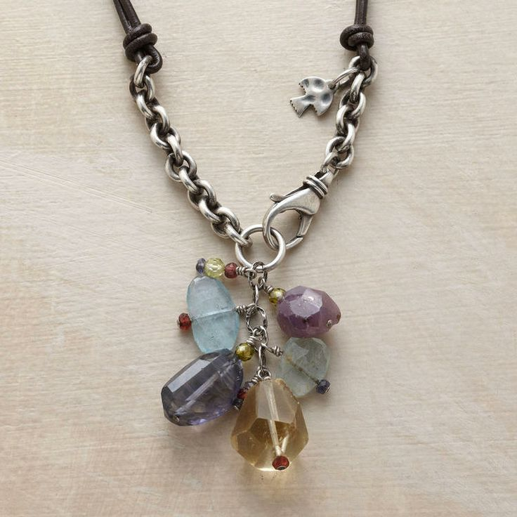 "GEMSTONE TASSEL LEATHER NECKLACE -- Double strands of leather cord play counterpoint to brushed sterling links tasseled with rose-cut aquamarine, faceted ruby, citrine, iolite, peridot, garnet, zircon and cubic zirconia. Silver lobster clasp. Stones may vary in size and color. Imported. Exclusive. Approx. 18""L."