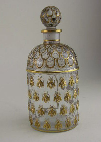 """An antique Guerlain """"Bee"""" perfume bottle. First created in 1868(?) for Eau de Cologne Imperiale for the Empress Eugénie, wife of Napoleon III. I can't date the one in the picture without actually seeing it but it looks as if it's one of the earlier ones. #Guerlain #antique #BeeBottle"""
