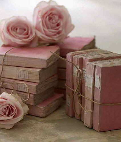 pretty in pink books...get cheap books at goodwill and spray paint them whatever color you want and put twine around it. cheap and easy