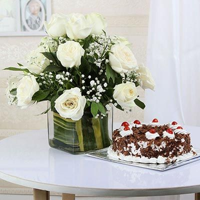 Half Kg Black Forest Cake with 12 White Roses In A Glass Vase