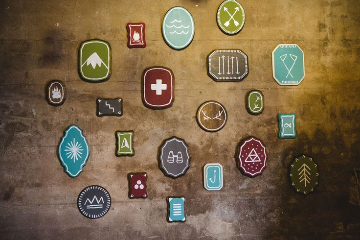 Camp Circa. Circa Lighting's Holiday Party 2013.  Design was inspired by the great outdoors and all things camp(y). DIY scout badges painted on wood plaques from Michaels. Would look great in a kids bedroom or playroom.  Design by Rethink Design Studio | Savannah, GA |