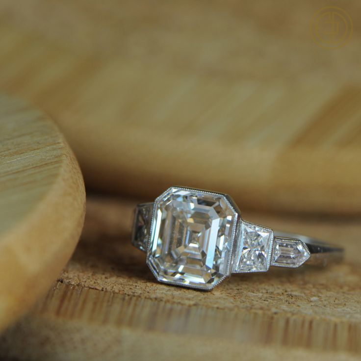 Antique Asscher Cut Diamond Ring with bezel set side stones