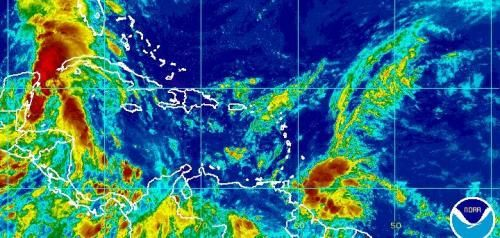 The National Hurricane Center said a system in the Atlantic will grow to a tropical storm as it moves through the Windward Islands, which…