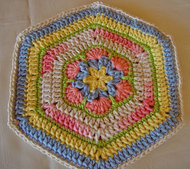 Ravelry: DKLady's Pastel Flower Potholder  Pattern. This would be perfect in any of the Darling Dahlias' kitchens--so beautifully retro!