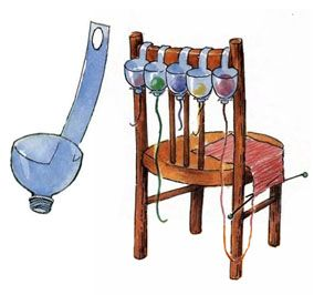 Yarn holders! The long strip wraps around the chair back and the hole snaps over the top of the bottle.  How handy is that?!