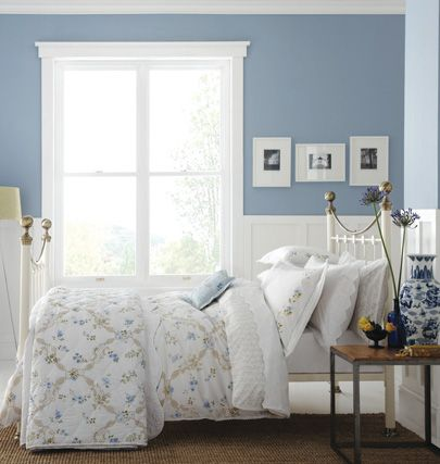 Blue walls with a mix of grey for main bedroom