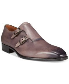 Mezlan masters dress fashion with these sleek and imposing double monk strap loafers. | Leather upper; leather sole | Imported | Plain toe with perforated medallion detail | Slip-on style with double