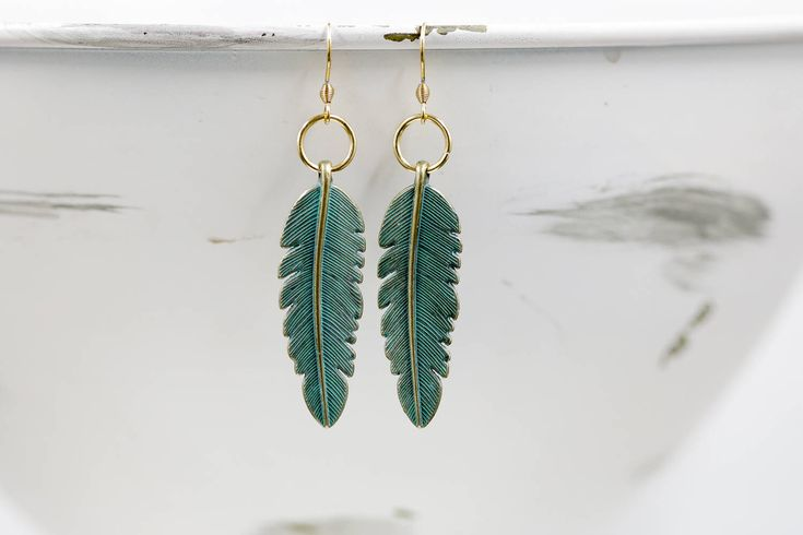 Patina and Gold Feather Charm Earrings / Gold Color Stainless Steel Findings by BeautyfromashesUSA on Etsy https://www.etsy.com/listing/549120744/patina-and-gold-feather-charm-earrings